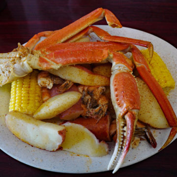Crab legs top a Lowcountry boil of shrimp, potatoes, corn and sausage
