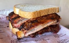 Half rack of ribs between two slices of white bread