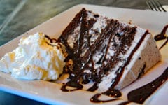 slice of oreo cake with fresh whipped cream ... New Bedford seafood